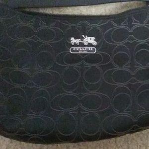 A black Coach mini purse